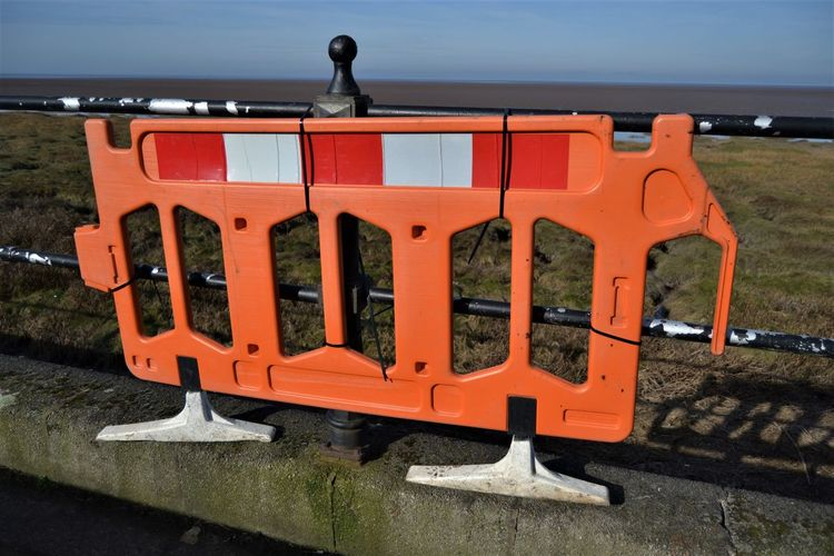 Orange and white plastic warning barrier to raise awareness of a broken railing on the sea wall at Knott End on Sea, Lancashire UK Orange Color No People Nature Day Water Safety Architecture In A Row Outdoors Sky Security Transportation Metal Communication Protection Sea Close-up Land Technology Red Signage Warning Sign Broken Fence Railing Barrier The Art Of Street Photography