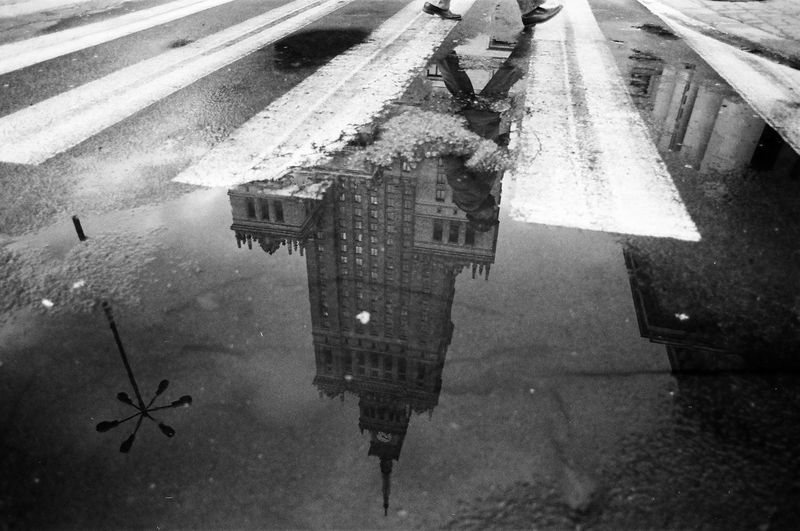 ANALOG Ilford Pan 100 The Week on EyeEm Light And Shadow Analogue Photography Nikonphotography Street Photography Bnw Capture The Moment Film Photography Black And White Puddle Reflection Water Rain Wet Architecture City High Angle View Transportation Street Nature Day Rainy Season Road Built Structure No People Monsoon Building Exterior Outdoors The Art Of Street Photography