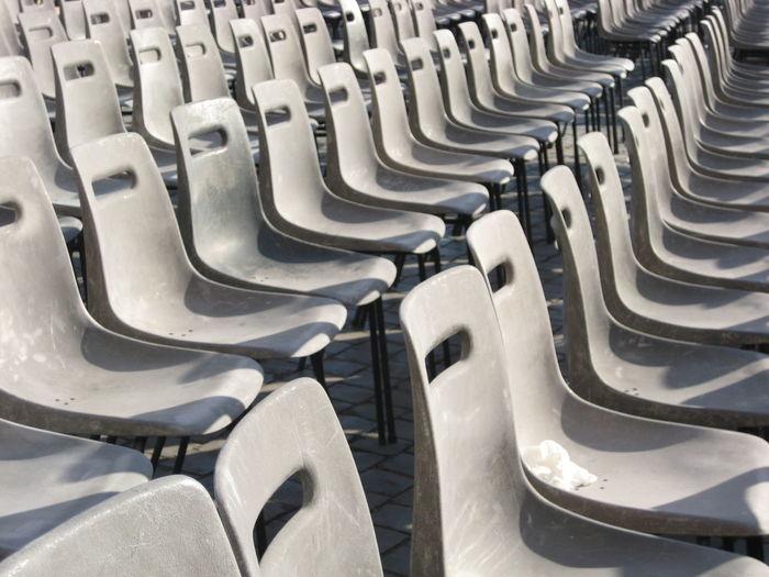 Full Frame Shot Of Empty Seats Arranged In Stadium