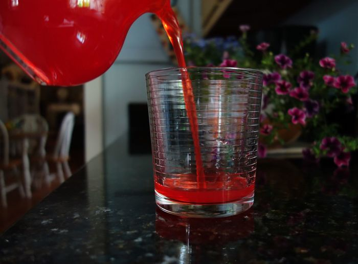 Close-up of red wine glass on table