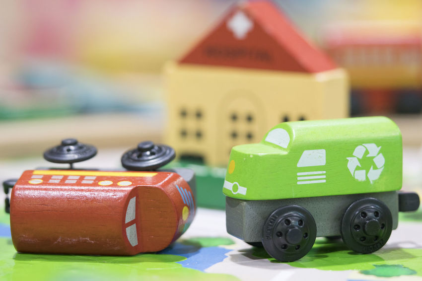 Wooden toy two trains on road with hospital in backdrop (selective focused),Toys for kids indoor playground Toy Toy Car Car Green Color Toy Block No People Motor Vehicle Focus On Foreground Group Of Objects Multi Colored Building Mode Of Transportation Close-up Transportation Wood - Material Small Small Group Of Objects Wooden Toys Wooden Toy Block Wooden Toy Train