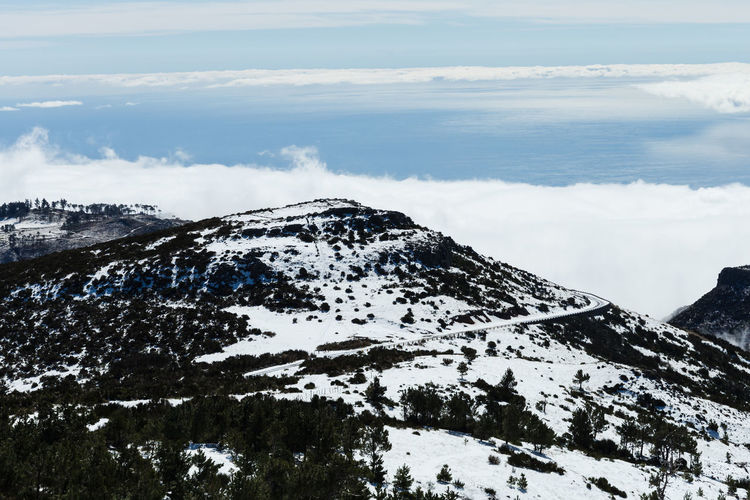 Road to pico do areeiro mountain covered with snow in madeira island