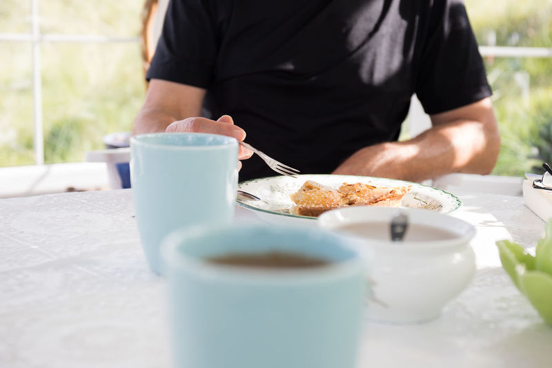 Fork Breakfast Cake Fork Close-up Coffee - Drink Coffee Cup Day Drink Food Food And Drink Freshness Holding Human Hand Indoors  Men Midsection Nusshain 09 17 One Person People Piece Of Cake Real People Selective Focus Table