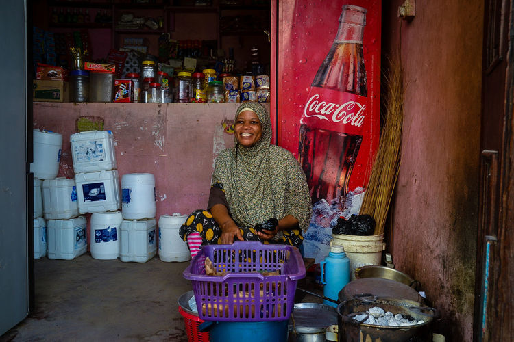 Africa Architecture Building Exterior Built Structure Casual Clothing Coca Cola Collection Culture East Africa Information Sign Kenya Mombasa Kenya MombasaRaha Multi Colored Person Retail Display Street Food Street Food Worldwide Swahili Coast Swahili Wear Swahili Woman Text Three Quarter Length