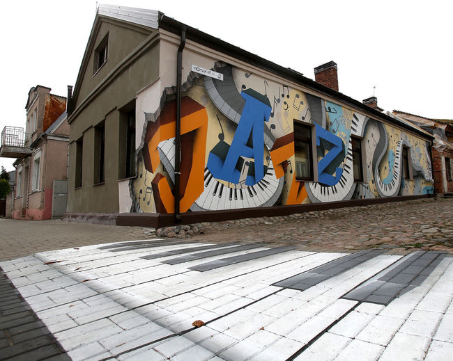 Jazz Kedainai Kedainiai Old Town Lithuania Architecture Art And Craft Building Building Exterior Built Structure City Clear Sky Communication Creativity Day Footpath Graffiti House Lithuania Travel Nature No People Outdoors Residential District Sky Street