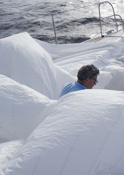 Man relaxing on snow covered bed