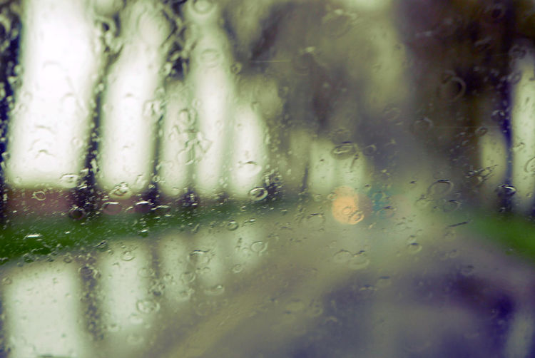 Backgrounds Close-up Day No People Rain Water Weather Window View Through My Windshield Rainy Road Diminishing Perspective The Way Forward Wet Windshield Droplet Road Season  Drop Selective Focus Rainy Season Mode Of Transport Defocused