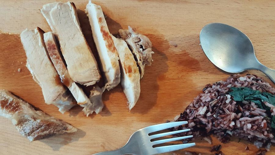 Baked Pork with Rice Berry Served on Wooden Kitchen Board - Table Food Indoors  Food And Drink Close-up Freshness SLICE Steak Eat Protein Sliced Fork Spoon Spinach Launch