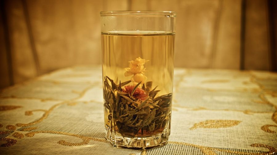 Close-Up Of Fresh Herbal Tea On Table