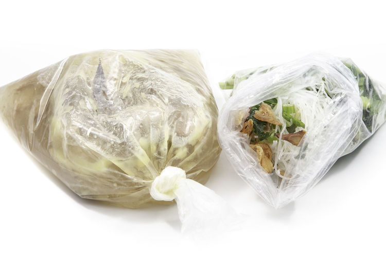 White Background Studio Shot Plastic Cut Out Still Life Indoors  Wrapped Close-up Plastic Bag Freshness Bag No People Healthy Eating Food And Drink Wellbeing Food High Angle View Ready-to-eat Vegetable Directly Above Polythene Vegetarian Food