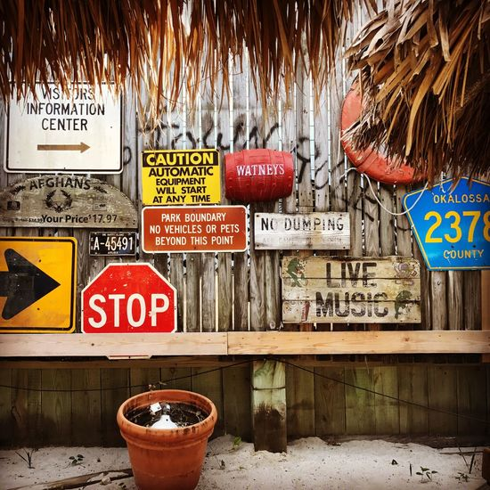 Beach Life Highway Signs Palm Fronds Beach Bars Communication Florida Life Florida Scene Grayton Beach Red Bar Road Signs Signboard Text Warning Sign