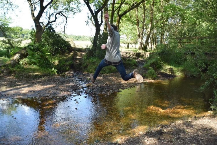 Water Tree Casual Clothing Nature Full Length Day Outdoors One Person Reflection Leisure Activity Sunlight Real People Boys Family Time Family Walk New Forest, Hampshire. UK Godshill Hampshire Leaping Branch River Jumping Beauty In Nature Young Adult Second Acts