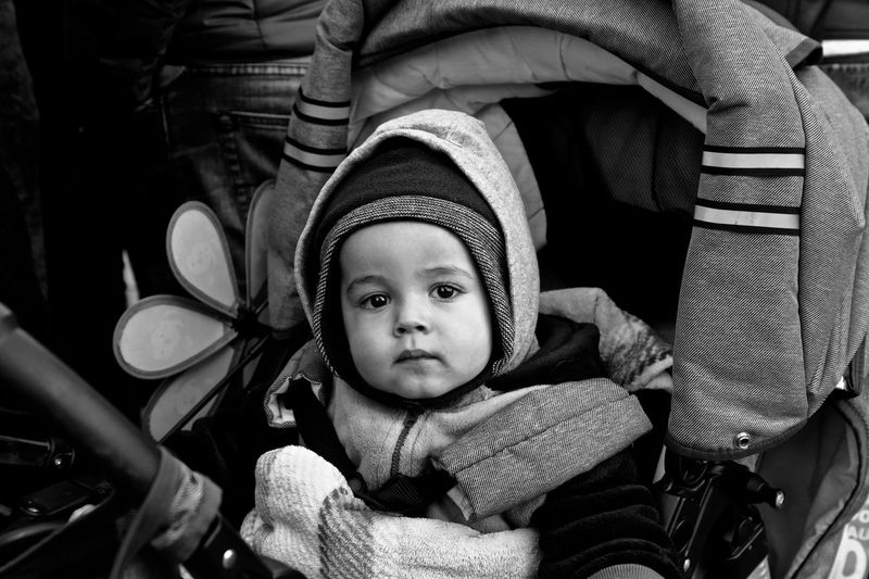 Uno sguardo rubato. Cold Temperature Welcome to Black Blackandwhite Babyboy Baby Stolen Eyes EyeEmBestPics EyeEm Best Shots Light And Shadow Canon5Dmk3 Childhood Child Baby Real People Young Babyhood Cute Toddler  Portrait Innocence Baby Stroller Front View