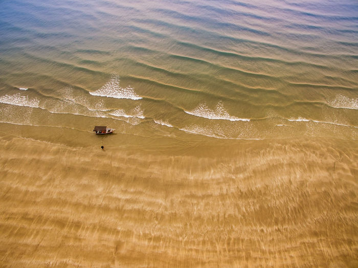 aerial view fisherman boat at beach during morning sunrise Aerial View Beauty In Nature Boat Day Nature No People Ocean Outdoors Rippled Sand Scenics Sea Shore Tourism Tranquil Scene Travel Destinations Water