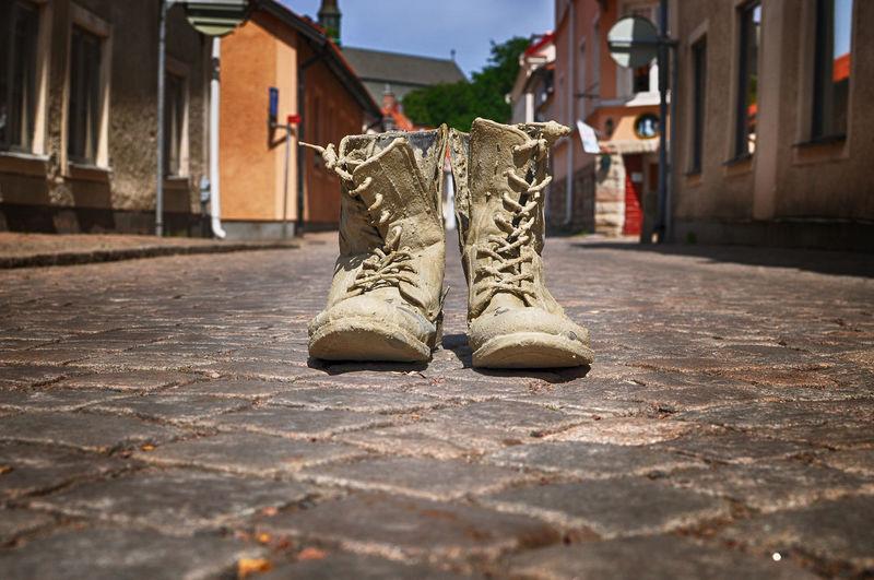 Muddy Boots On Street