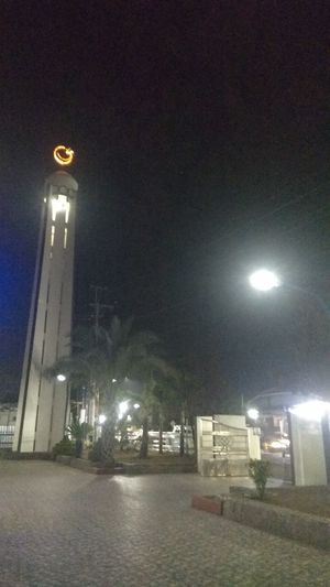 Low angle view of illuminated street light against building at night