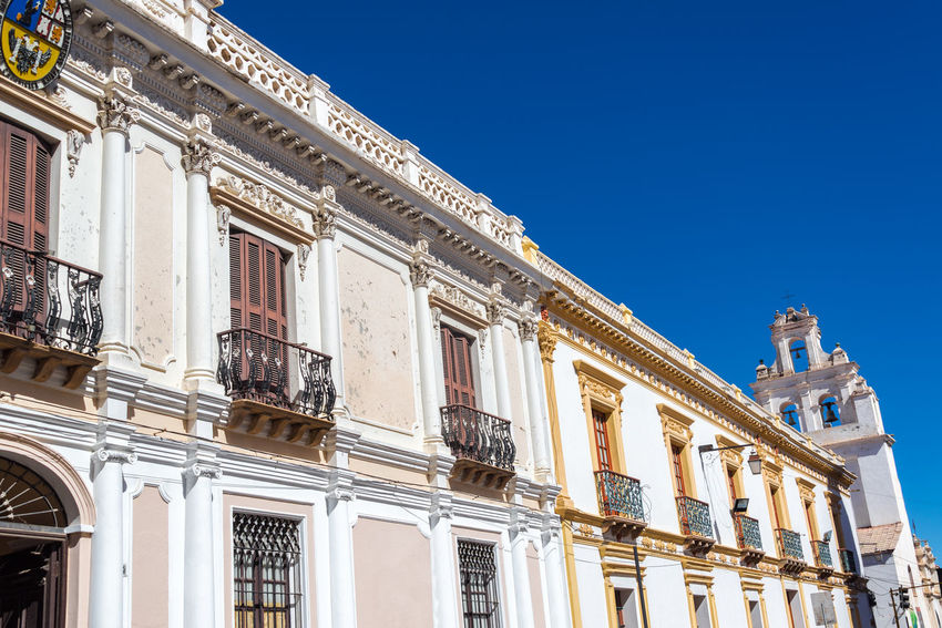 Row of white colonial buildings in Sucre, the White City of Bolivia America Andes Architecture Background Bolivia Bolivian Building Capital City Cityscape Culture Cultures Day House Landmark Landscape Latin Outdoors South Street Sucre Town Travel Urban View