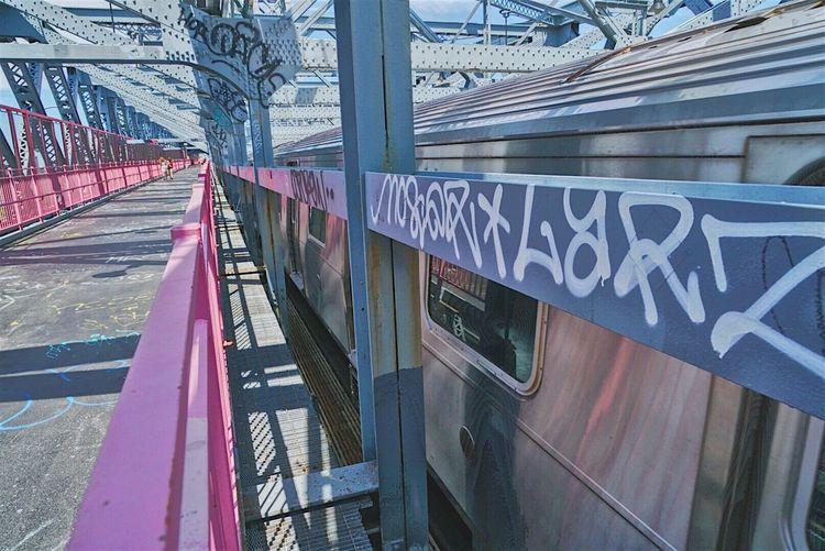 Text on railway bridge