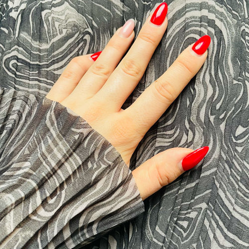 Close-up of woman hand on red fabric
