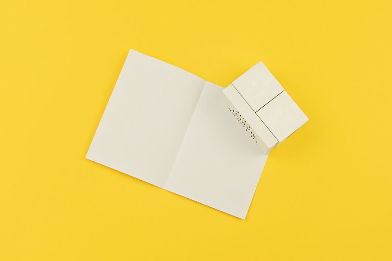 Flat lay with vintage wooden block calendar and white empty blank on a yellow background to celebrate Happy Fathers Day with date 16st June. Greeting card concept to celebrate Father's day Mockup Template Empty Day Blank Calendar Happy Mock Up Gift Dad Greeting Celebration Card Holiday Concept Event Object Composition Yellow Celebrate Fatherhood  Flat Lay Lifestyle Congratulation Note Date Paper White Sheet Isolated Block Celebrating Concepts Craft Cube Daily Handmade Minimalism Notice Number Planning Vintage Wooden Open Space Copy Space Background Studio Shot Still Life Yellow Background High Angle View Document Message