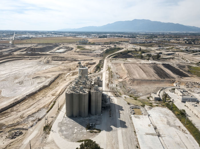 Colton, CA / USA - 4/07/2019: Overhead view of the CalPortland aggregate plant. Environment Sky Landscape Day Nature Industry No People High Angle View Outdoors Scenics - Nature Land Fuel And Power Generation Mining Quarry Aggregate Cement Plant Construction Earth Towers Storage