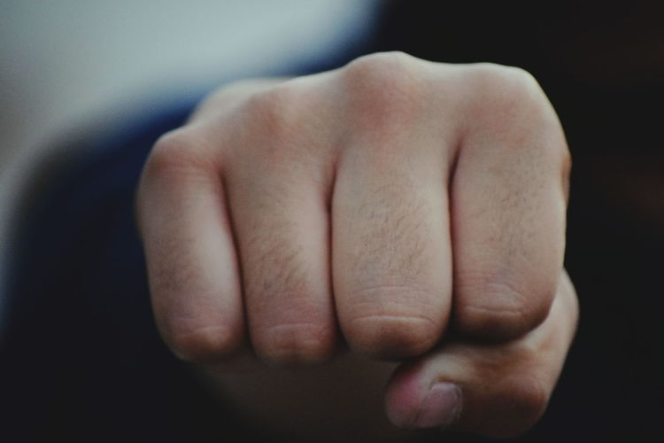 Close-up of person clenching fist