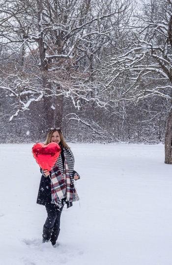 Love Valentine Bare Tree Beauty In Nature Cold Temperature Day Forest Full Length Happy Time Hearts Leisure Activity Lifestyles Nature One Person Outdoors People Playful Real People Scenics Snow Tree Warm Clothing Weather Winter