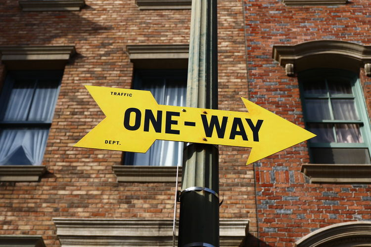 ONE WAY SIGN America Canon EOS 7D Mark II Communication Direction Directional Sign Getty Getty & Eyeem Getty Images Getty X EyeEm Getty ımages Gettyimages Guidance Hello World Information Old Building  Old Town One Way Sign Road Sign Sign Taking Photos Text Warning Sign Western Script Window Yellow