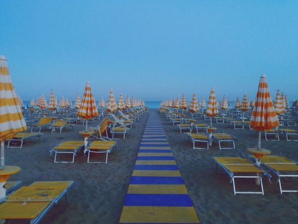 Evening Sky Beach At Sunset Yellow Blue Umbrellas On The Beach Jesolobeach Summertime Summer Views Summernight Beach Life Vacations