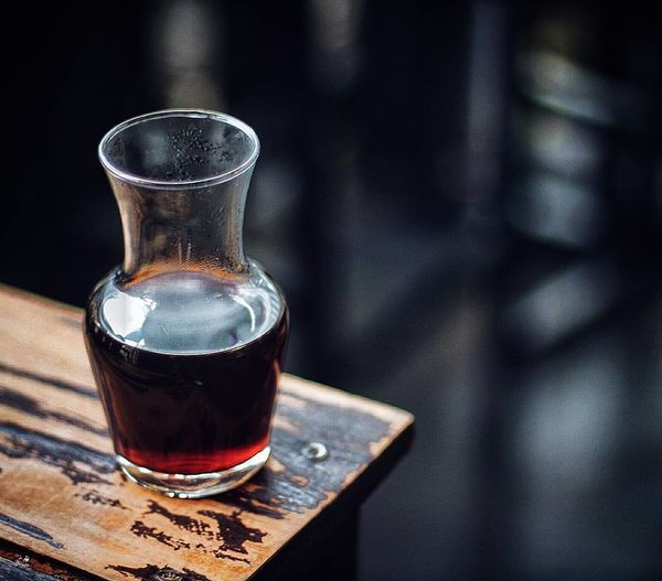 Close-up of red wine carafe on table