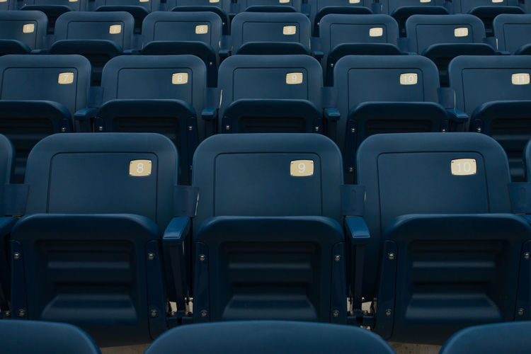 My obligatory shot whenever i visit US Open tennis court here in New York. Court Tennis Arrangement Chair Chairs Empty Folding Chair In A Row No People Number Numbers Repetition Seat Stadium Symmetrical Symmetry