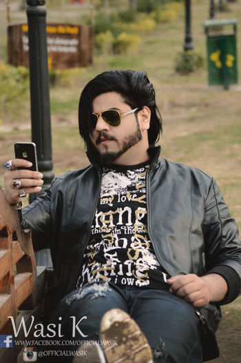 #OfficialWasiK #Wasi #WasiKhan Casual Clothing Communication Day Front View Leisure Activity Lifestyles Mobile Phone One Person Outdoors Portable Information Device Real People Smart Phone Sunglasses Technology Wireless Technology Young Adult Young Men Young Women