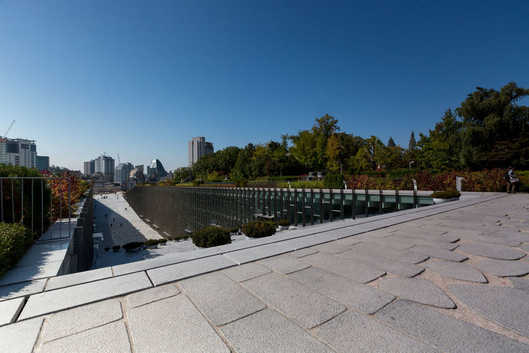 Campus of EWHA - Woman's University of Seoul, south Korea. Architket: Dominique Perrault Architecture Perrault Seoul Seoul, Korea Architecture Building Exterior Built Structure City Cityscape Clear Sky Day Ewha Ewha Womans University Modern Nature No People Outdoors Sky Skyscraper Travel Destinations Tree Urban Skyline Water
