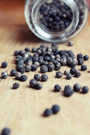Close-up of black peppercorn on table