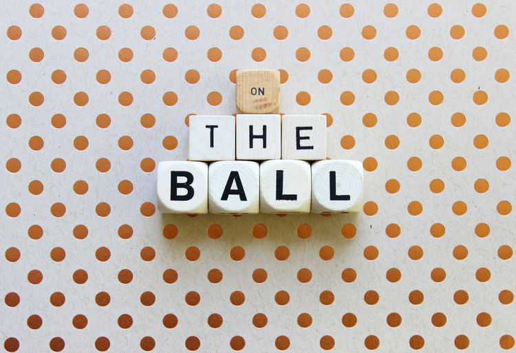 Directly Above Shot Of On The Ball Text Made From Dice