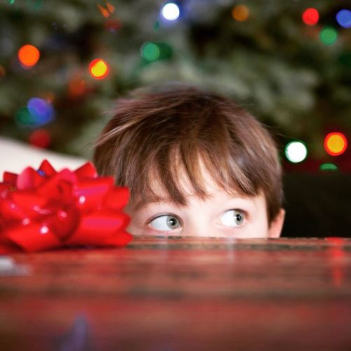 Close-Up Of Boy At Table During Christmas