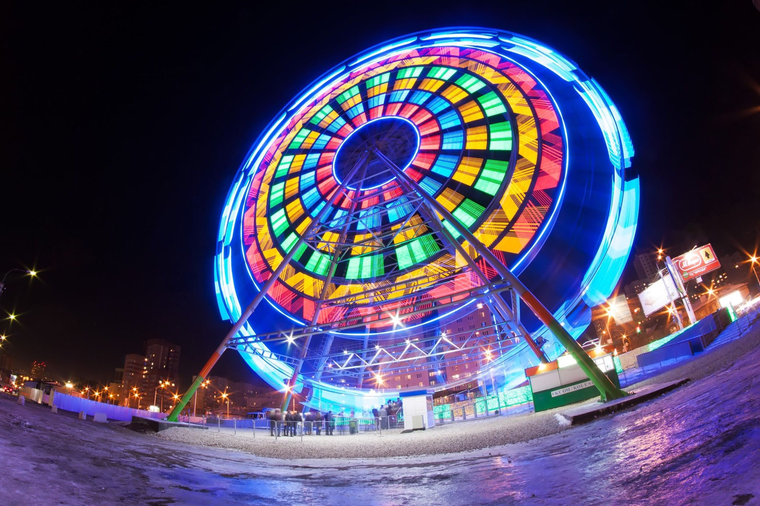night, illuminated, built structure, architecture, multi colored, building exterior, blue, arts culture and entertainment, ferris wheel, circle, water, clear sky, amusement park ride, travel destinations, famous place, amusement park, copy space, travel, tourism, waterfront