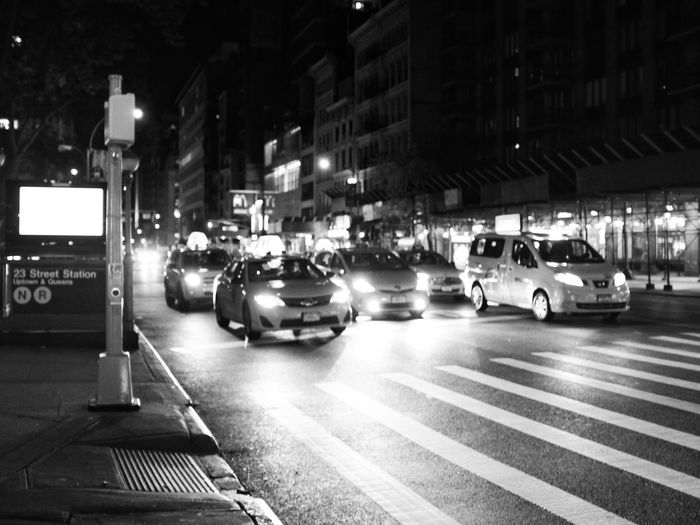 Taxis are ready to go in the 23rd street in New York. USA New York 23rd Street  Taxis Night Street Street Photography X100t Fujifilm Black And White Monochrome Photography