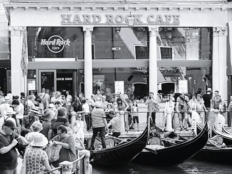 Hard Rock Cafe City Breaks City Breakers Venice, Italy Gondola Vintage Canals And Waterways Gondoliere Boat Places Summer Memories Lifestyles Outdoors Blackandwhite Boat Dock Gondole Sea Life Streetphotography Popular Turism Life Rock People Together Takeover Contrast Music Brings Us Together
