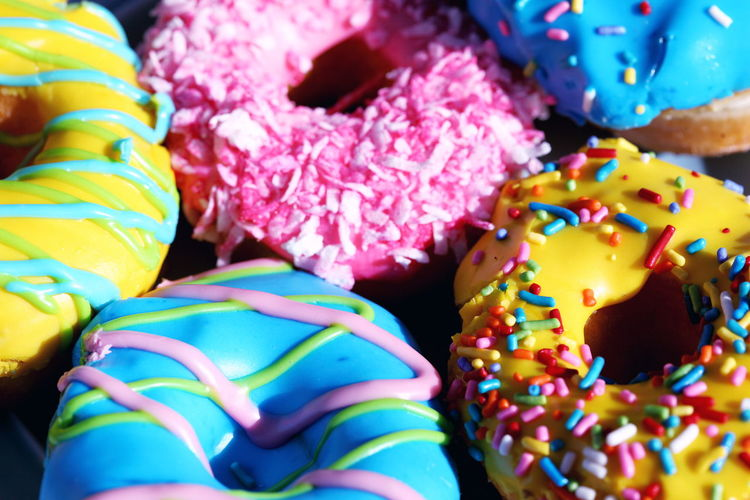 Frosting Icing Baked Chocolate Choice Close-up Colorful Dessert Donut Food Food And Drink Freshness Indoors  Indulgence Multi Colored No People Retail Display Snack Sprinkles Still Life Sweet Sweet Food Temptation Unhealthy Eating Variation