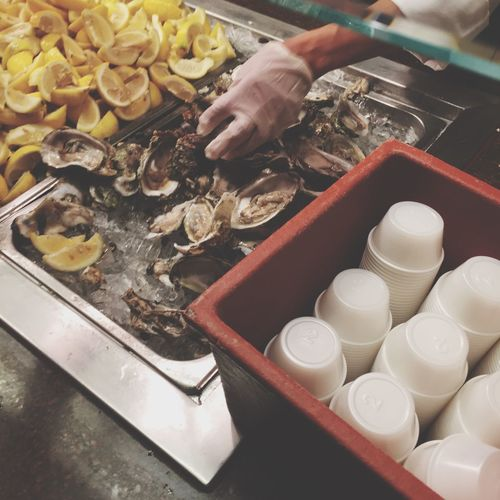 High Angle View Of Person Arranging Fresh Oysters And Lemon At Sandia Resort And Casino