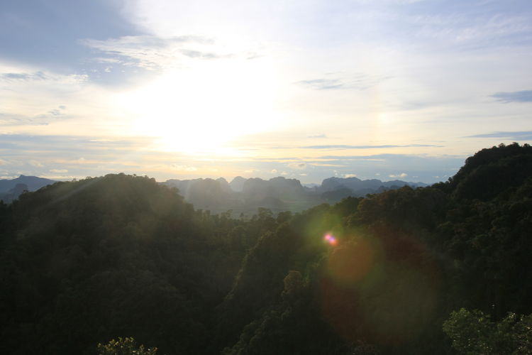 View from the buddhist temple in Krabi Town, Thailand. Krabi Krabi Thailand Thailand Beauty In Nature Cloud - Sky Landscape Lens Flare Mountain Mountain Range Nature Sky Sun Sunlight Sunset Tranquil Scene