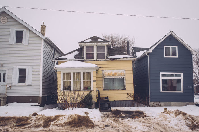 Architecture Building Exterior Built Structure Cold Temperature Crooked House Day Gloomy Winter House Neighborhood No People Outdoors Row Of Houses Snow Winter