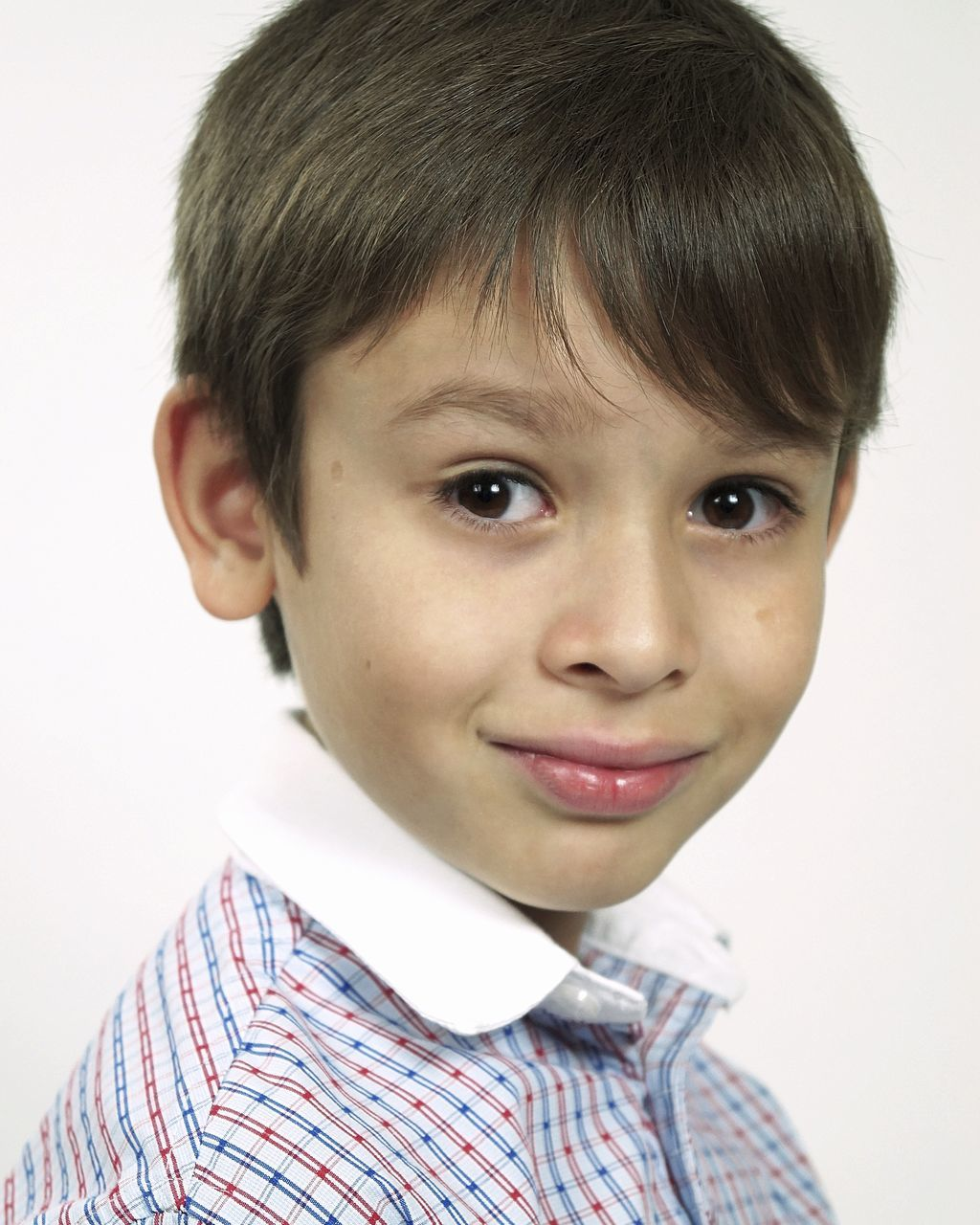 portrait, childhood, looking at camera, boys, headshot, one person, smiling, innocence, studio shot, head and shoulders, white background, real people, cute, happiness, human face, close-up, indoors, one boy only, people