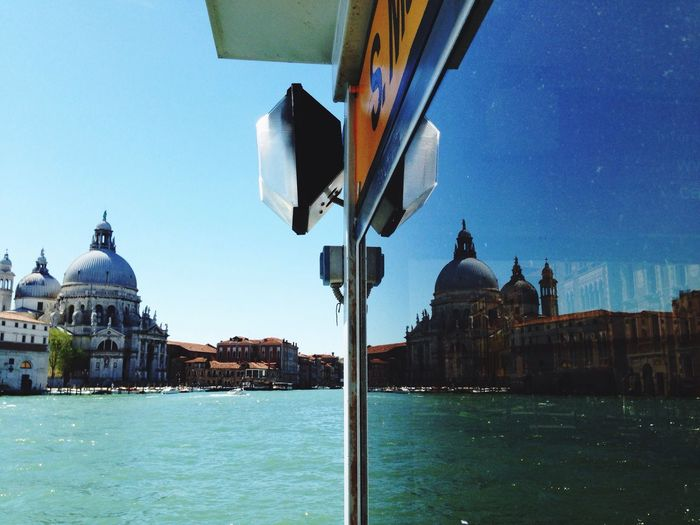 Reflection Of Santa Maria Della Salute By Grand Canal On Glass