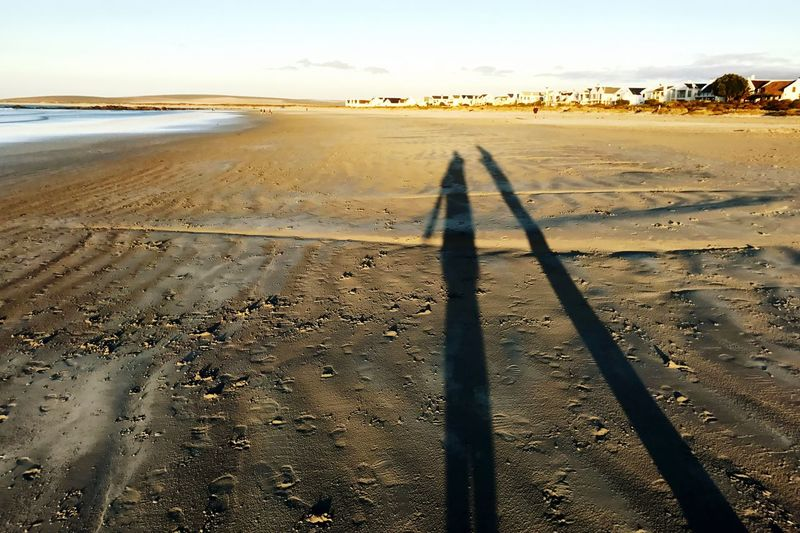 Sunset on the Beach with long Shadows