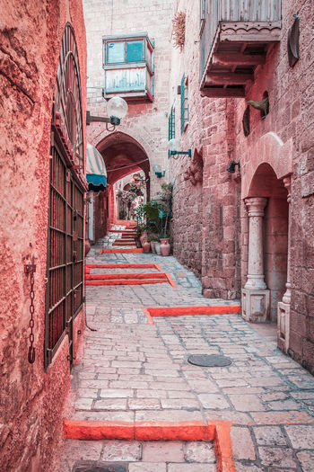 Narrow alley in Old Jaffa - an ancient city, part of Tel Aviv, Israel Jaffa Alley Ancient City Architecture Building Exterior Built Structure Day Israel Landscape Narrow Street No People Outdoors Red Tel Aviv Yaffo