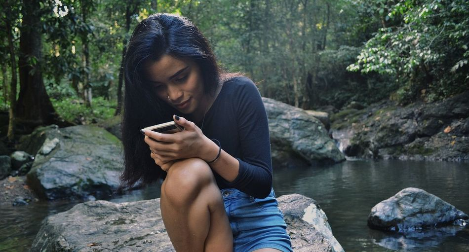 Only Women One Woman Only Looking Down Rock - Object River Nature Outdoors Beautiful Woman Water Relaxation Kuchingborneosarawak [ Sarawak VSCO Borneo Iban Nikon Landscape Hikingadventures Landofhornbills Beauty Waterfall Motion Forest Waterfall In Mountain
