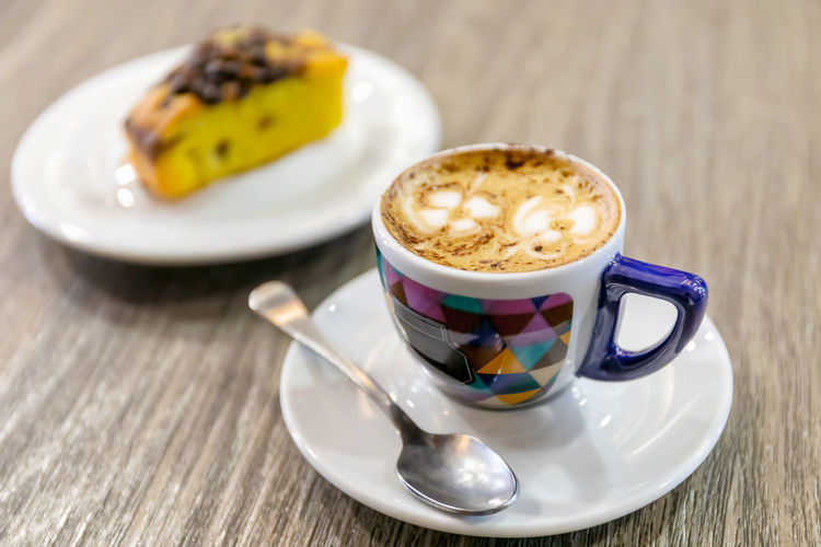 Close-up of coffee and cup on table
