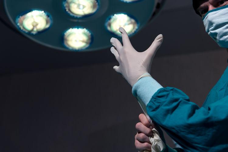 High angle view of people holding illuminated lighting equipment